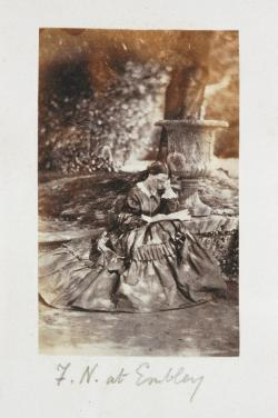 A young Florence Nightingale reading a book in front of a tree